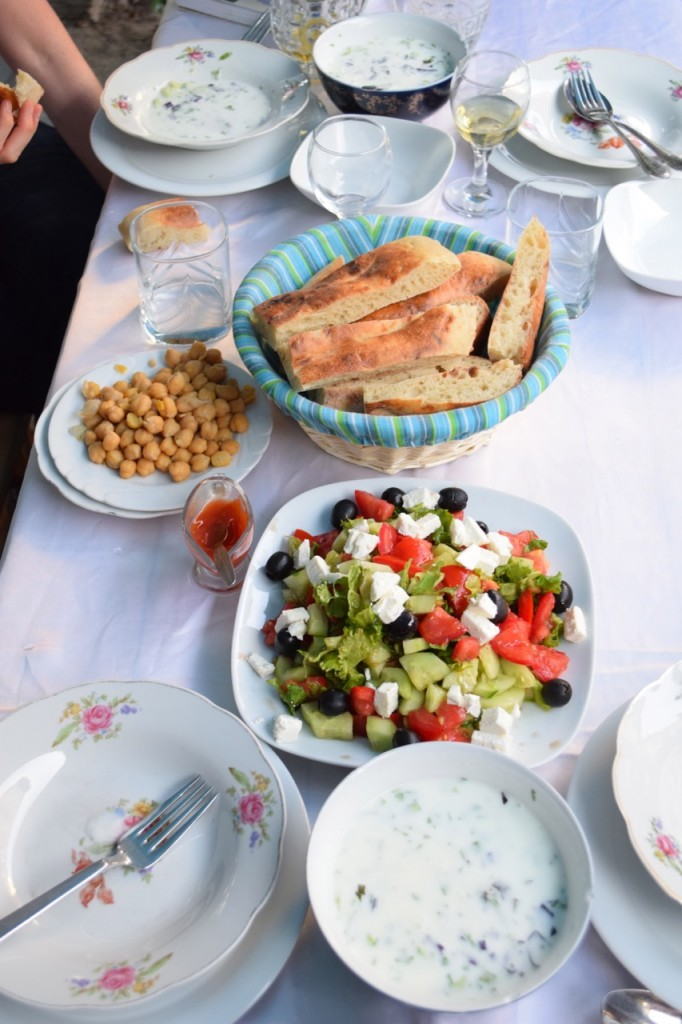 Bread, salad, chickpeas and fresh yogurt soup
